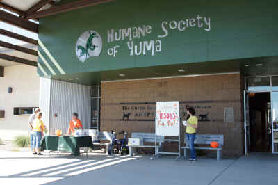The Humane Society of Yuma's 4050 South Avenue 4 1/2 E, Yuma, Arizona open door entrance welcome people to their fair weathered Fall Fest and Feral Cat Day, Saturday, 19 October 2013.
