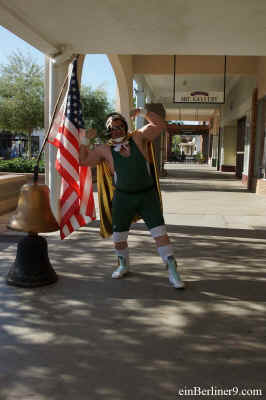 ein Berliner 9 flexes his biceps by the U.S.A. Flag at the Yuma Film Festival