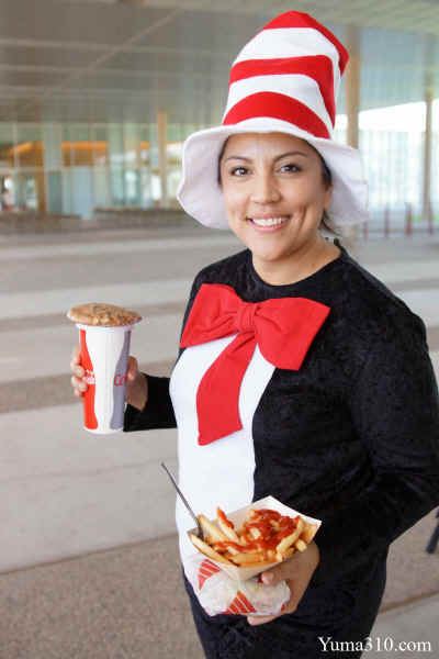 Josie Garcia, 35, an AWC Administrative Secretary in the Child Development Learning Lab (CDLL) portrays Dr. Seuss's Cat in the Hat. Garcia moved to Yuma, AZ from Los, Angeles, California.